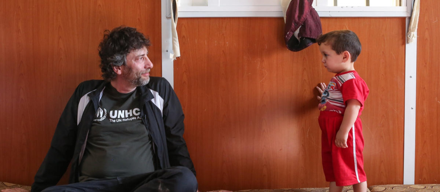 UNHCR High Profile Supporter, Neil Gaiman with Ayman, Syrian refugee volunteer nurse who provides medical assistance to the camp community.