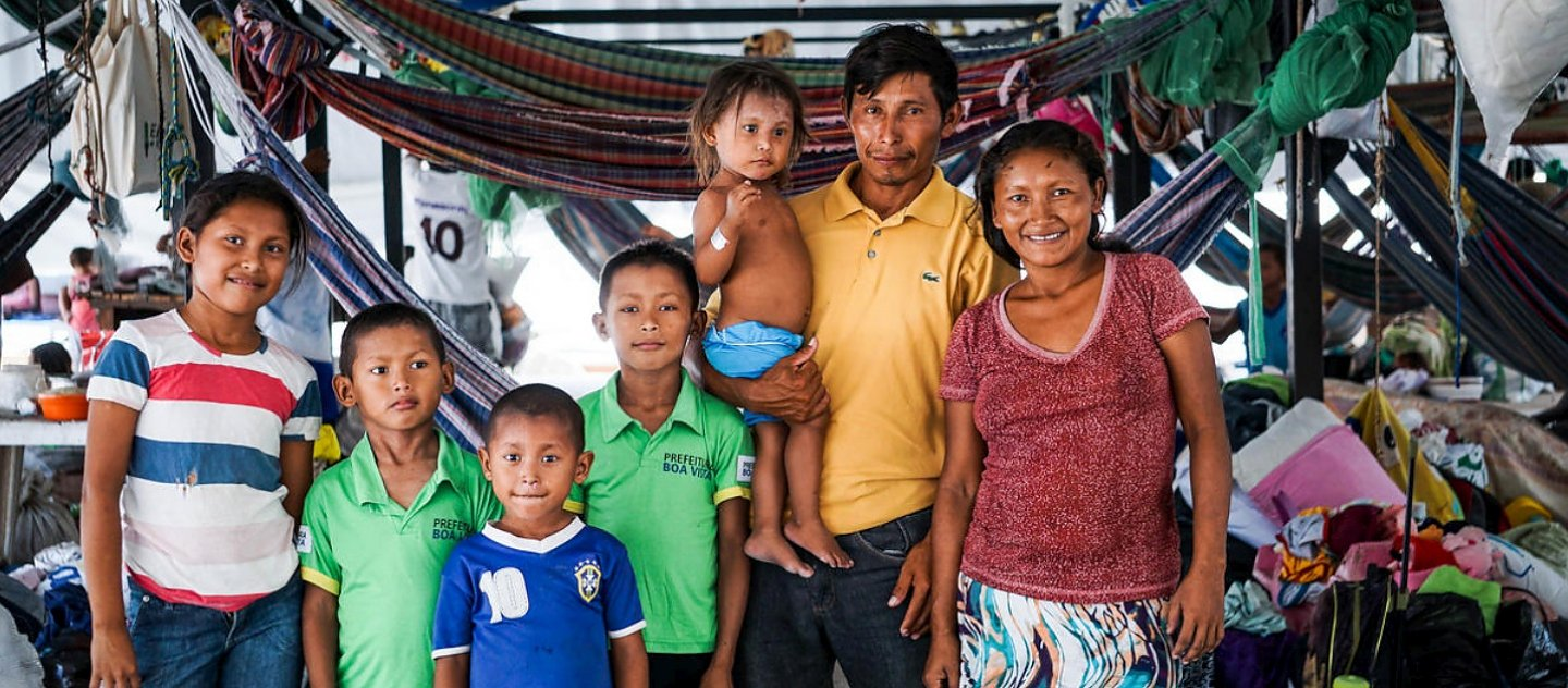Euligio Baez, a Warao leader from Venezuela, poses with his family in Boa Vista, Brazil