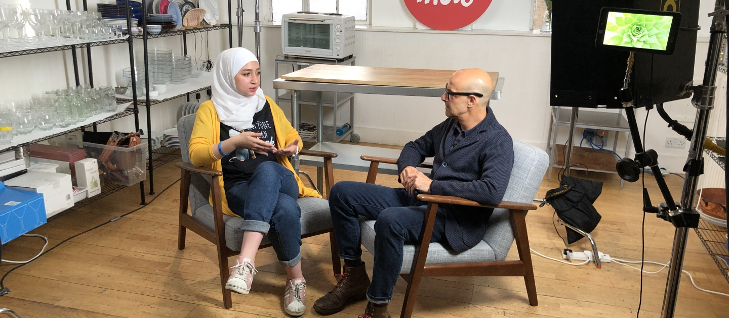 Stanley Tucci and Maya Ghazal on-set at Buzzfeed's Proper Tasty offices