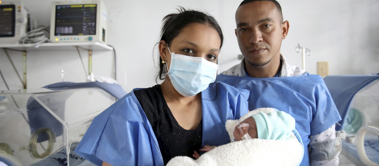 Parents Yonielys Villegas and José Miguel Sequera Borges visit their newborn son Enmanuel at the main maternity hospital in Bogota, Colombia.