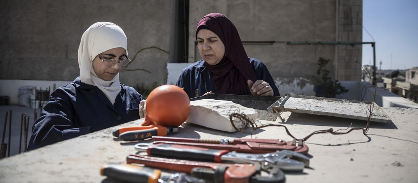 Jordan. Female plumber teaches refugees her trade
