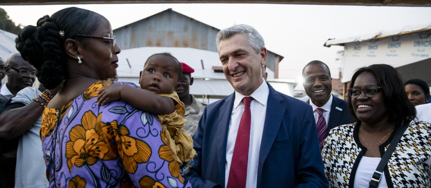 UN High Commissioner for Refugees Filippo Grandi greets a refugee on her return to Bangui, the Central African Republic.