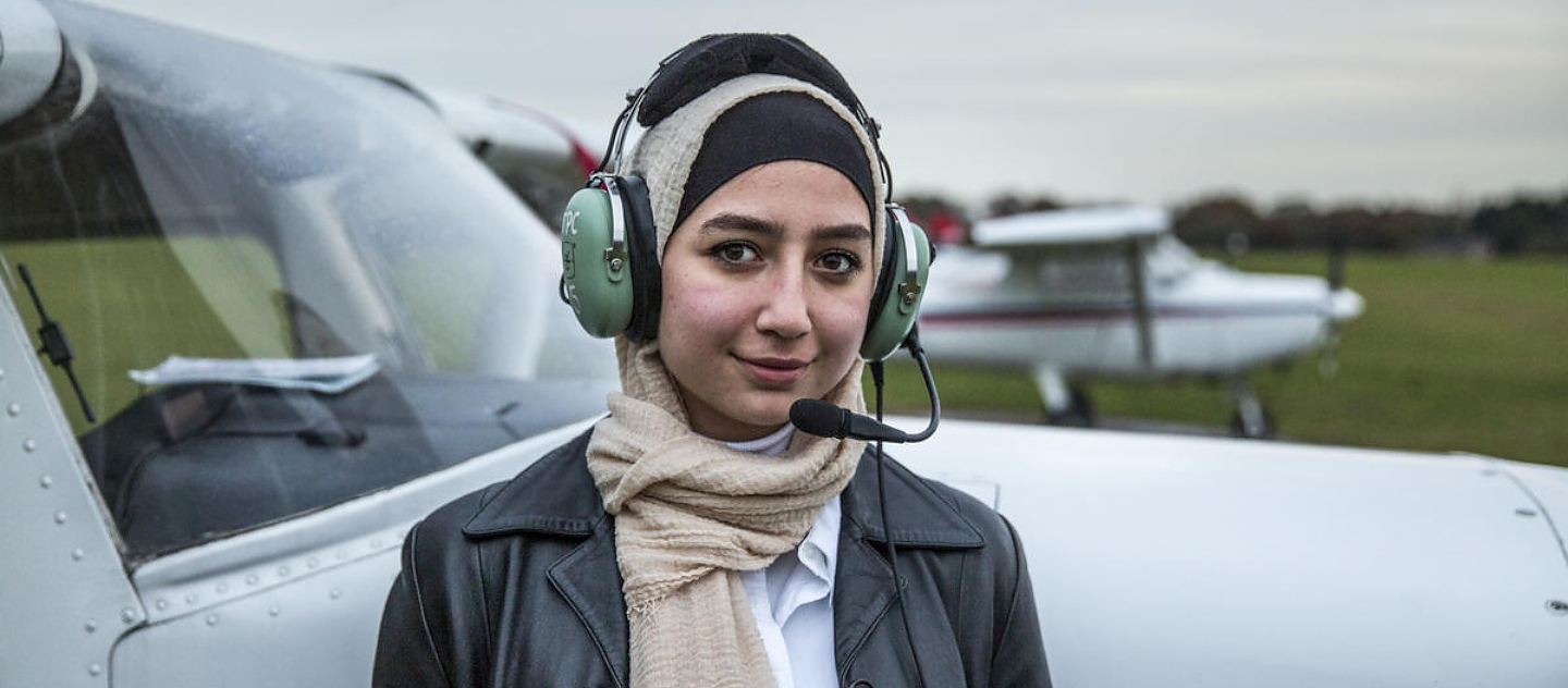 Maya Ghazal, 20, pictured after her first solo flight, at The Pilot Centre, in Denham, United Kingdom.