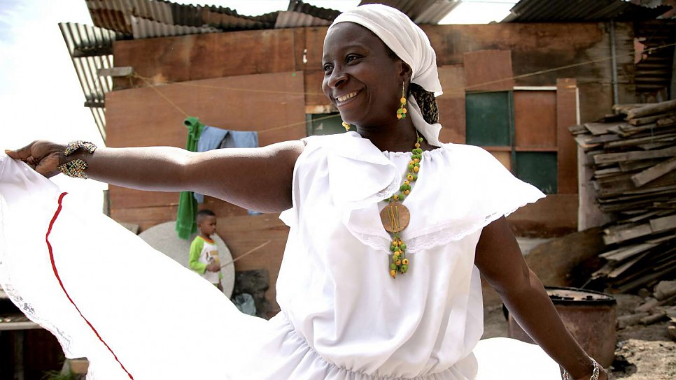 "Maribeth dances outside her house in Soacha, Colombia. ""My spirit is free when I dance and I am in another world""."