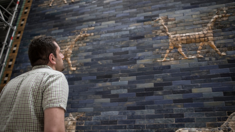Syrian refugee Ahmad Moutad, 27, admires the ancient Babylonian Ishtar Gate, part of the collection at Berlin's Museum of the Ancient Near East.