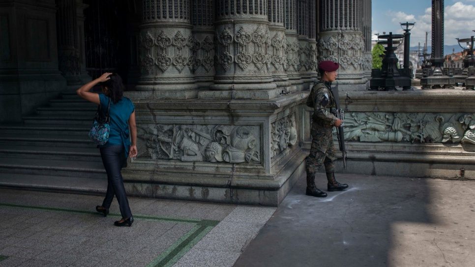 A soldier stands guard near the National Palace in downtown Guatemala City. The presence of troops, police and private security guards is widespread in the Guatemalan capital, which is one of the most dangerous cities in the world.