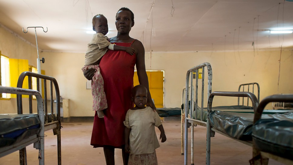 Cecilia Obere, 26, fled her home in Central Equatoria, South Sudan, with her twin daughters, Karleta and Lina (standing), when her community experienced severe food shortages.