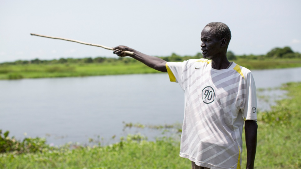 Gatluak Ruei Kon, 56, stands on his old farm in Old Akobo, in South Sudan's Jonglei State. He was separated from his family and his land for over two years after war broke out in 2013.