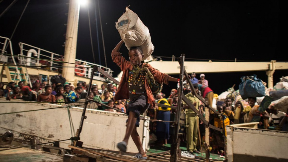 After waiting for days on the shore of Lake Tanganyika on Kagunga Peninsula, Burundian refugees disembark the MV Liemba in Kigoma. From here, they will be transferred to Nyaragusu refugee camp.