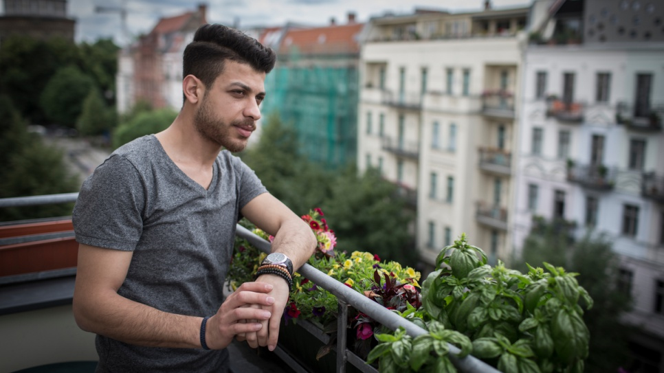 Abdallah Rahal views the trendy Prenzlauerberg neighbourhood of Berlin from his balcony. The Syrian singer, who fled Aleppo because of the war, says music can bring people hope.