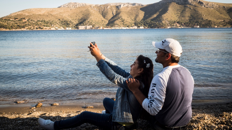 Ensaf and her father, Bashar, take a selfie to send to her mother and brother in Germany.