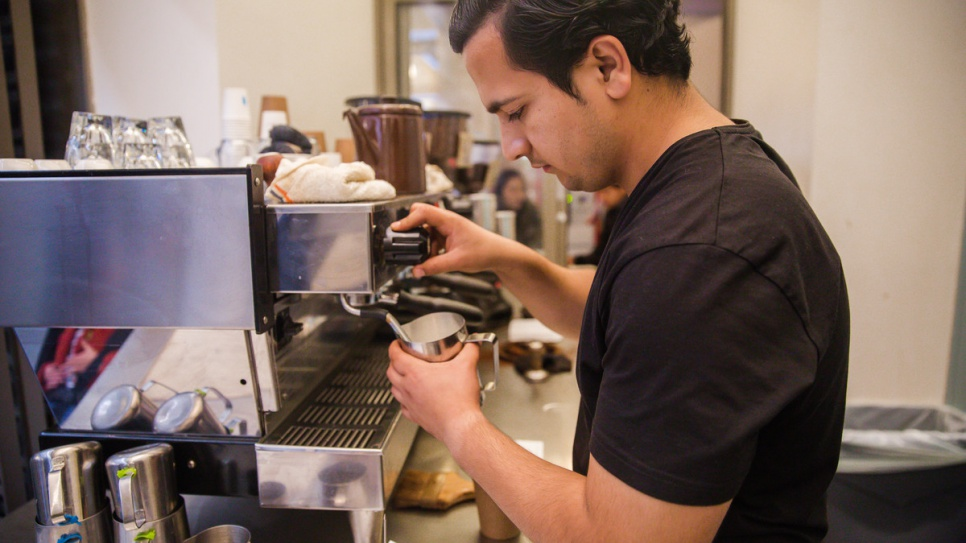 Samiullah Haidari, a refugee from Afghanistan, works his shift at Blue Bottle Coffee in San Francisco.