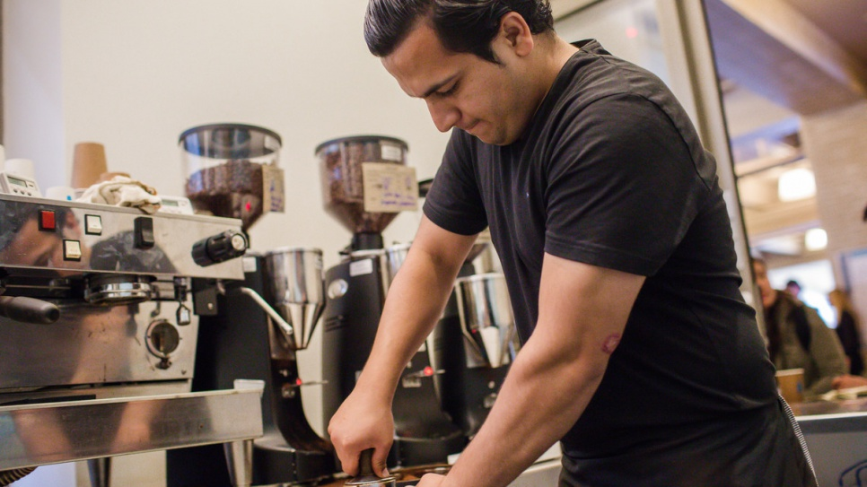 Samiullah puts to use the skills he recently learned during a barista training programme in Oakland, California.