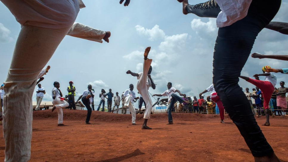 Central African refugees practice capoiera before an audience at Mole camp in Equateur Province, DRC, on 21 August, 2014.