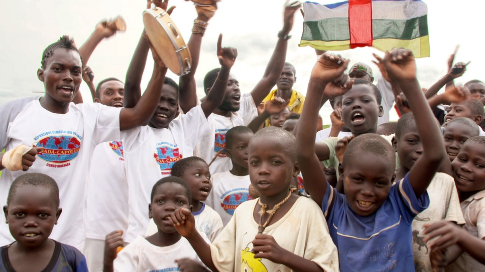 Young refugees from Central African Republic cheer as they watch capoeira at Mole camp.