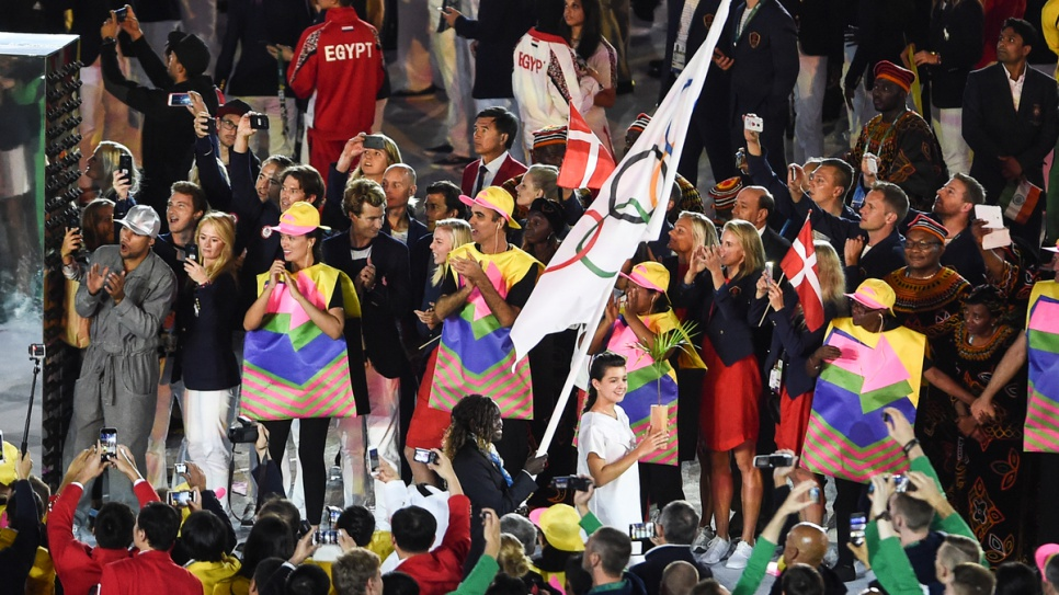 Rose, carrying the flag, leads the other members of the Refugee Olympic Team at the Opening Ceremony.