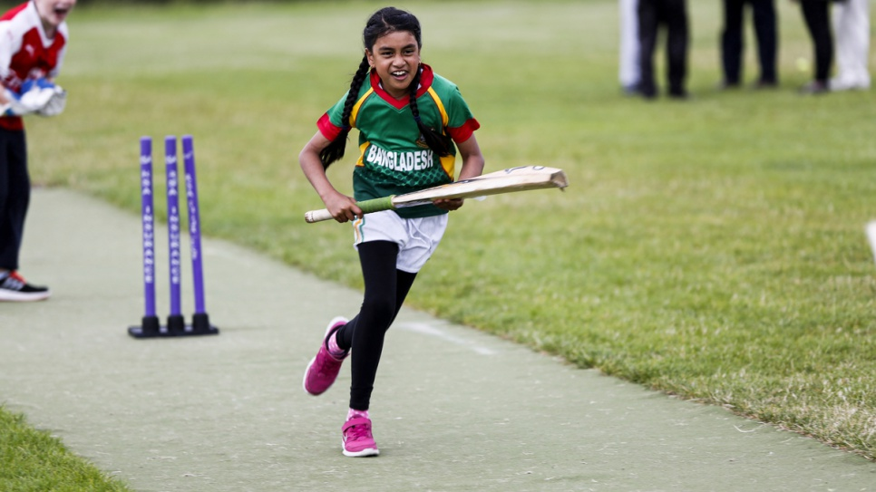 Wearing the Bangladesh cricket shirt, a young girl runs for the line in the hopes of scoring a point at the Carlow Cricket Club.