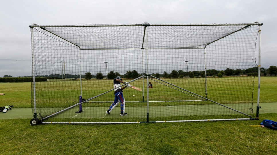 A Rohingya refugee practices batting in the nets at the Carlow Cricket Club.