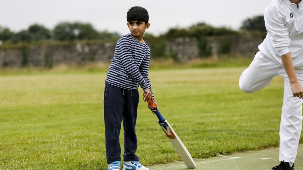 Younger children learn the basics of the game at Carlow Cricket Club.