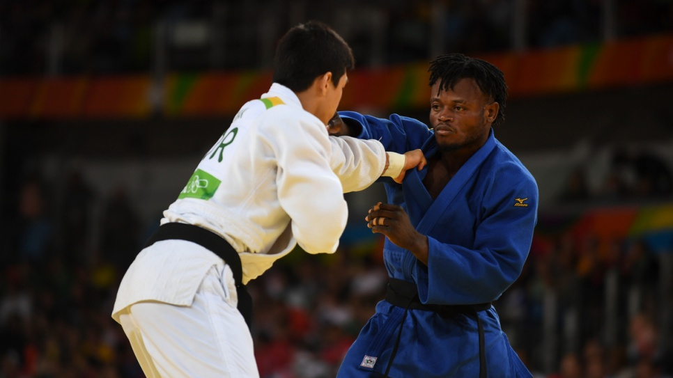 Popole takes on Donghan Gwak, a former world champion from the Republic of Korea, during his second match at the Rio Olympics.
