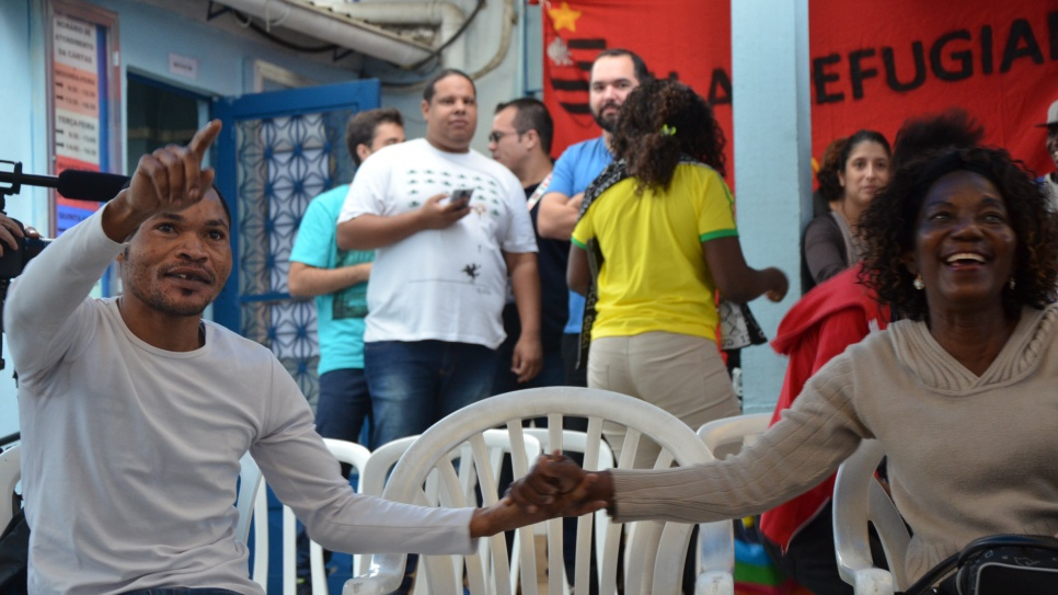 Congolese refugees in Rio celebrate Popole's Olympic victory.