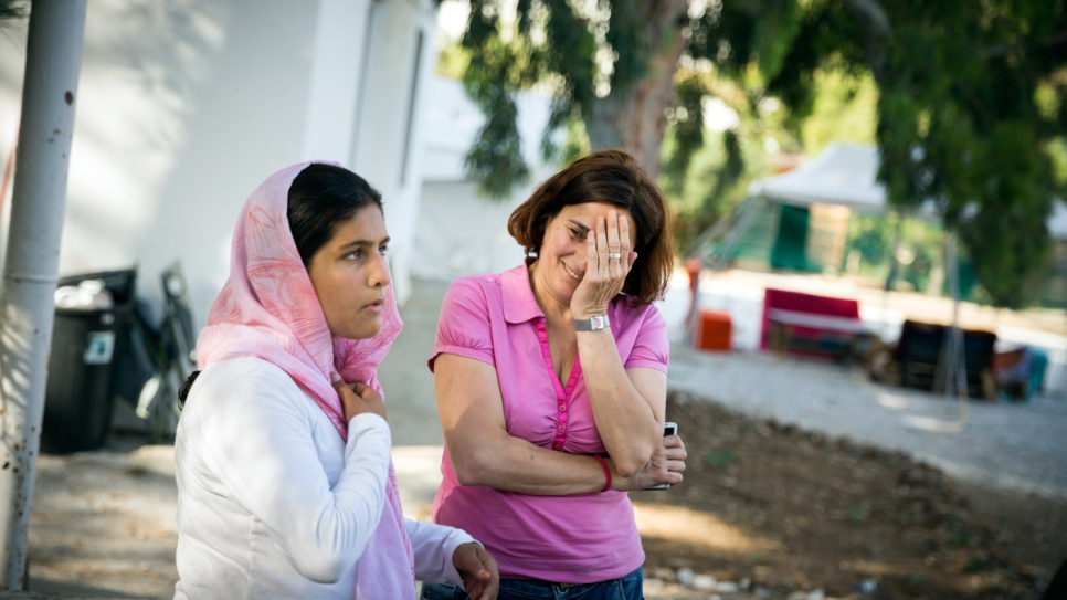 Efi Latsoudi speaks with 14-year-old Sahad from Afghanistan at PIKPA camp.