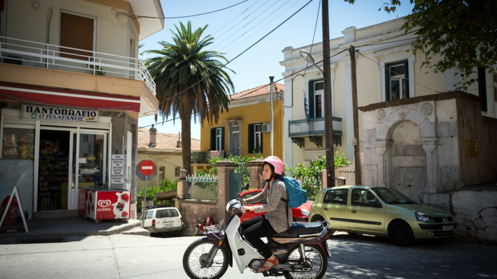 Efi Latsoudi rides her scooter from her home in Mytilene to a yoga session, run by volunteer Konstantin.