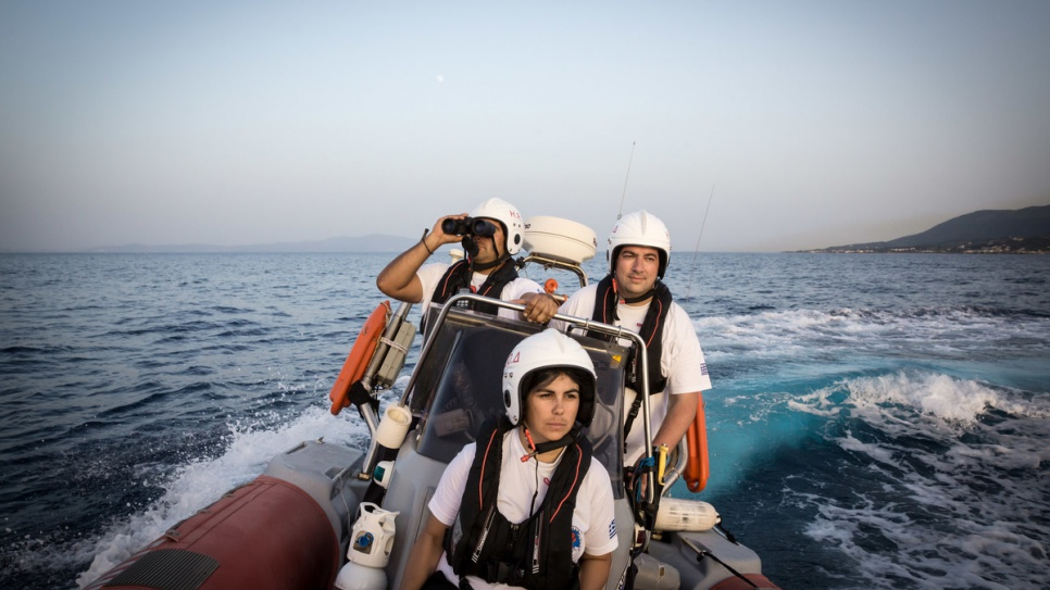 HRT volunteers Panagiotis (left) and Antigoni (centre) conduct a training exercise with Konstantinos (right).