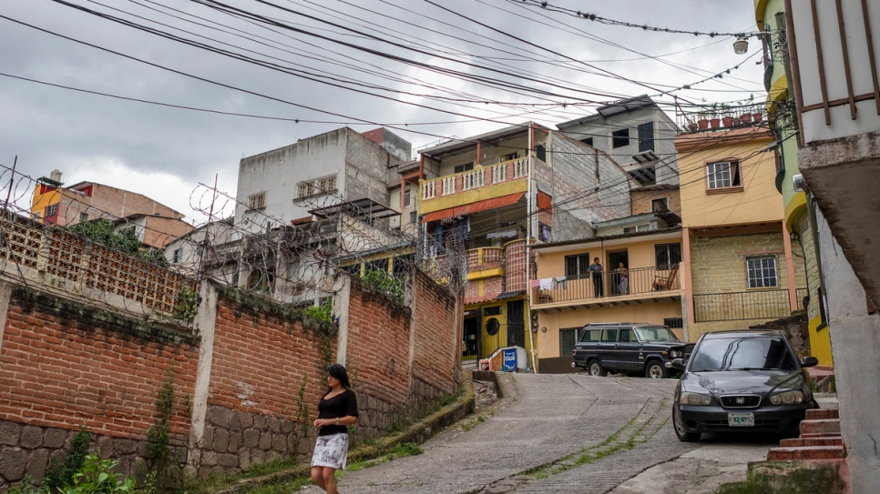 "A resident walks in the El Bosque neighbourhood in central Tegucigalpa. The area is among many in the Honduran capital considered dangerous because of the presence of local gangs known as ""maras."""