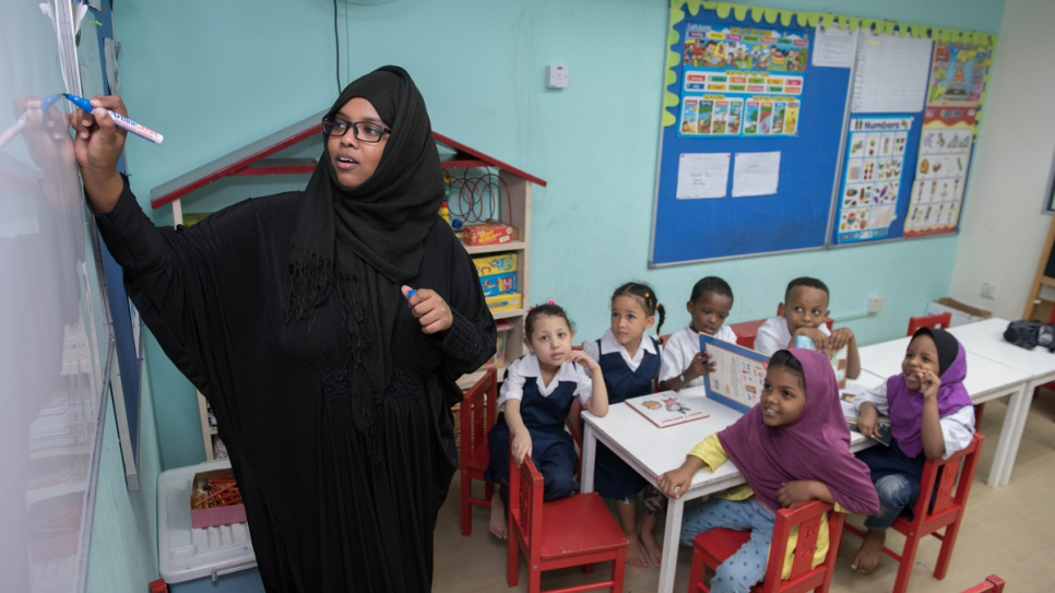Nawa did not step into a classroom until she was 16, but now is preparing to start university and also volunteers as a teacher at a refugee learning centre.