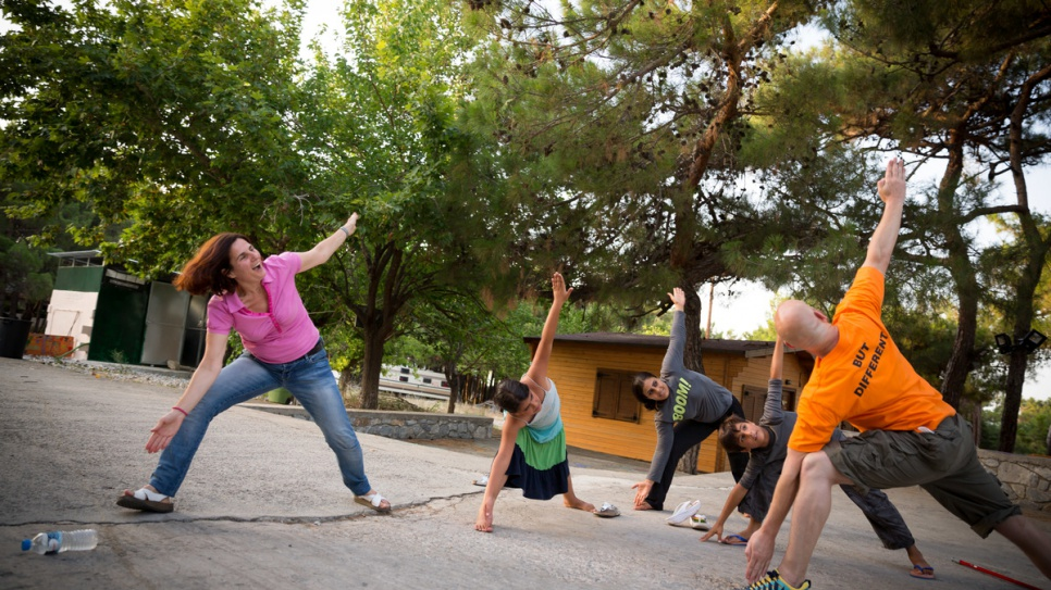 Efi Latsoudi practices yoga with three young refugees and instructor Konstantin, a volunteer from the United States.