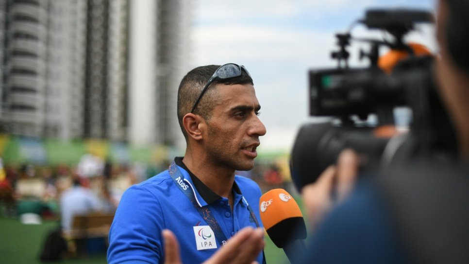 Independent Paralympic Team swimmer Ibrahim Al-Hussein meets reporters at the Paralympic Village in Rio de Janeiro, Brazil.
