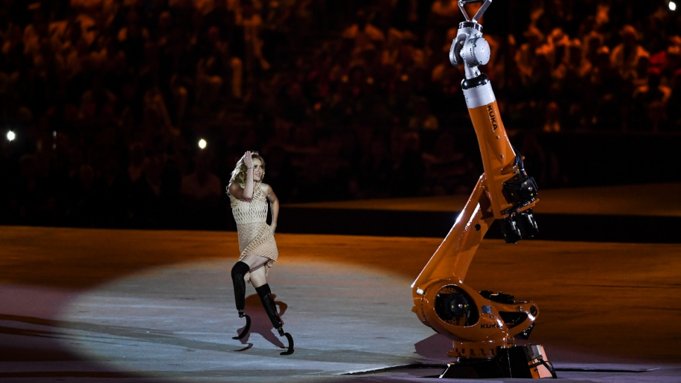 A performer with a disability dances with a robot at the Opening Ceremony of the 2016 Paralympic Games in Rio de Janeiro.