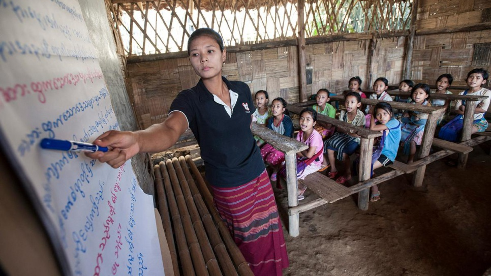 Sumeh, 26, is teaching Burmese to her Standard 2 class of Karenni refugee children. Sumeh, also a Karenni refugee, says the best thing about living at the Ban Mai Nai Soi camp in northern Thailand is free access to education for all children.