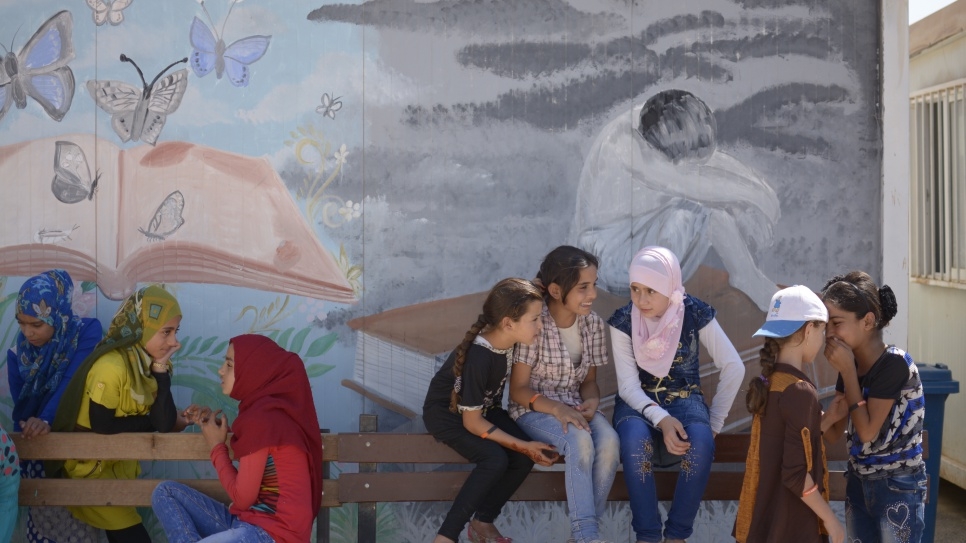 At Za'atari refugee camp young Syrian refugee girls gather for a meeting of TIGER (These Inspiring Girls Enjoy Reading) programme which targets refugee girls who have dropped out of school, or who are at risk of dropping out of school.