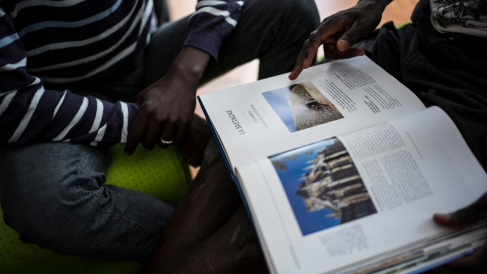 Manal, 16, from Darfur, reads a French geography book at a centre for unaccompanied children in Saint-Omer.