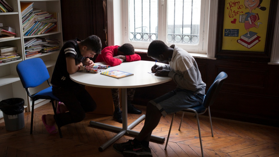 Unaccompanied children from Sudan and Afghanistan read, write and rest at a centre in Saint-Omer.