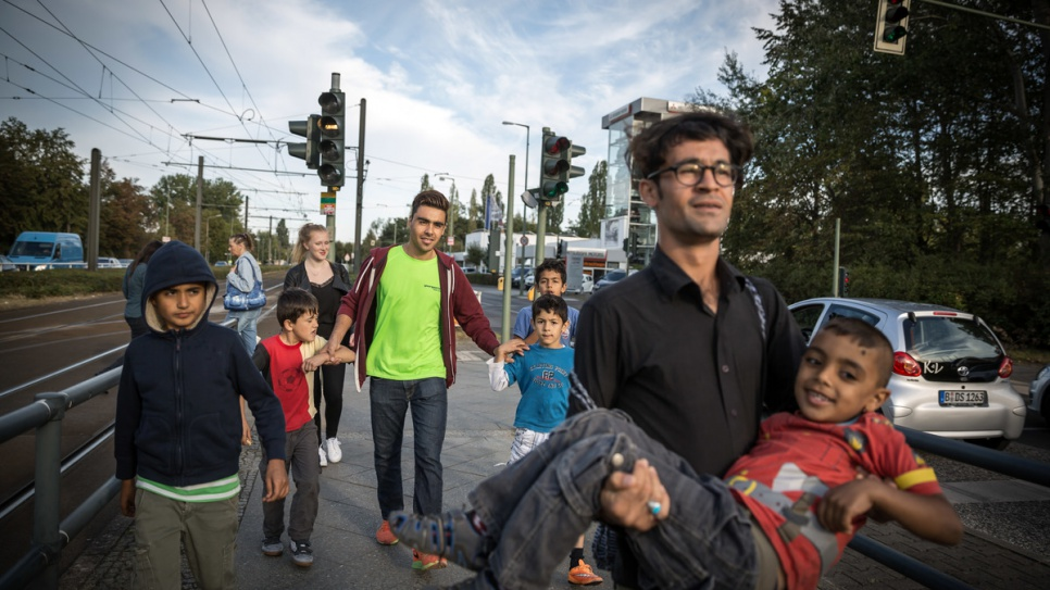 Hassan and his colleagues accompany some of the children back to their accommodation.