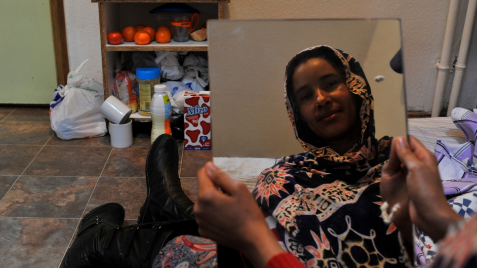 Sudanese refugee Seherezade in her room at the John Wesley homeless shelter, which helps refugees who have nowhere to live.