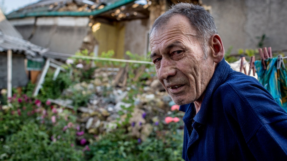 Vladimir Garmash, 66, outside the ruins of his home in eastern Ukraine.