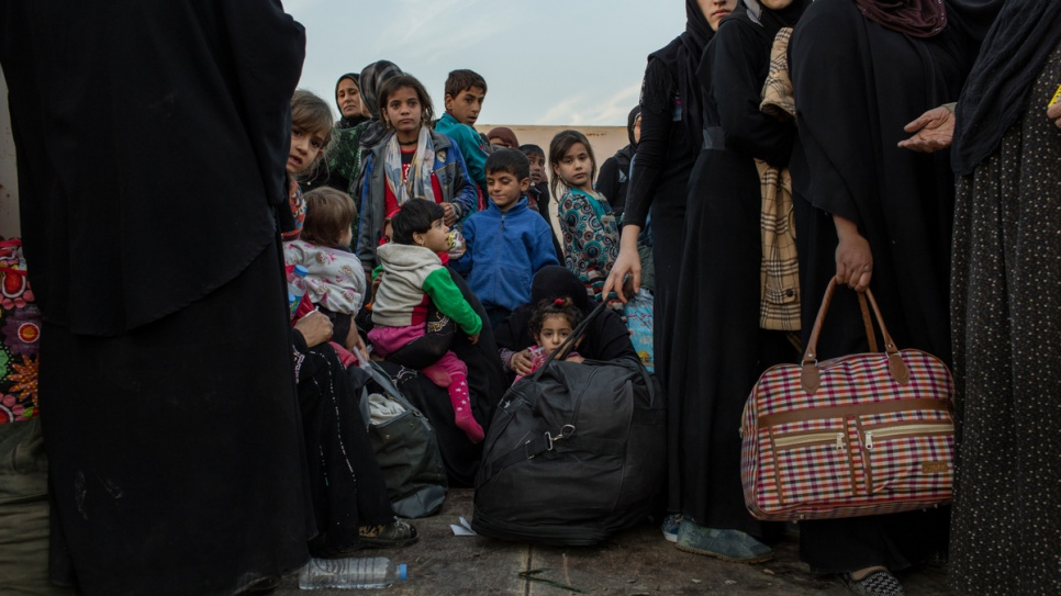Internally displaced Iraqi families from recently liberated districts of eastern Mosul arrive at Hasansham camp in the Kurdistan Region of Iraq.