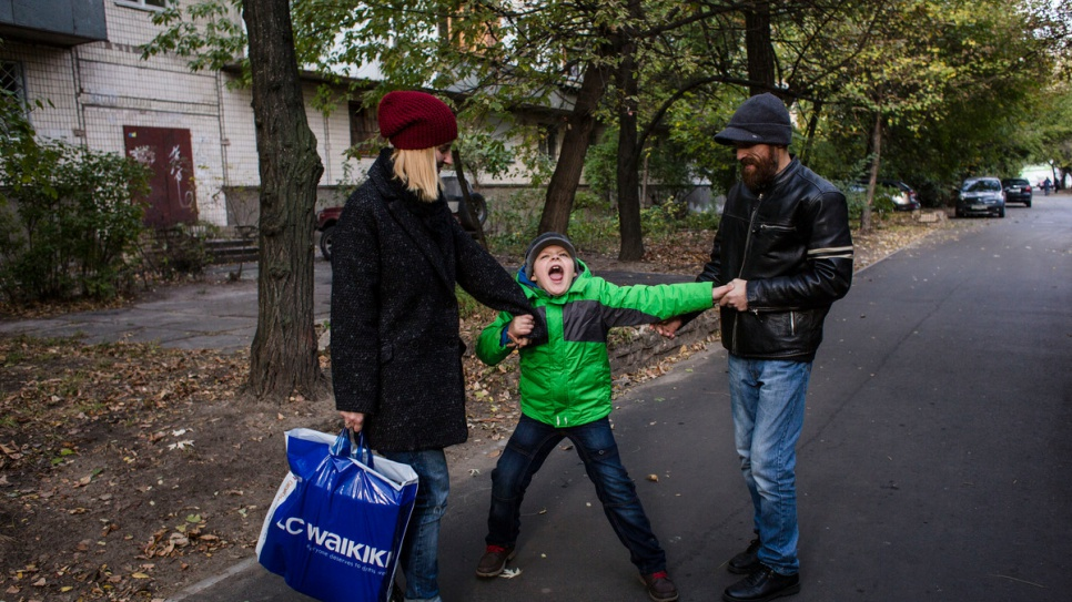 Anna, Igor and Gesha Gvozd walk home to their rental apartment in Kiev.