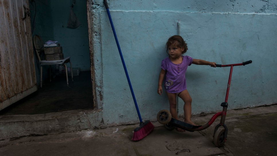 Brenda's granddaughter plays ouside the room rented by her family in Tapachula.