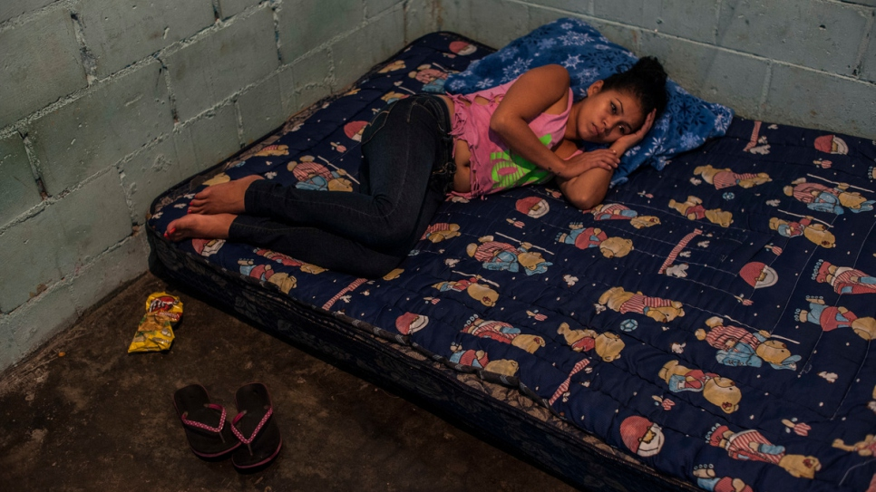 Erica rests in the room she rents with her family in Tapachula.