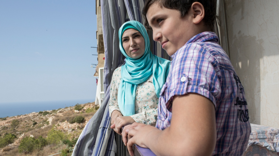 Since Alaa* (left) arrived in Lebanon in 2012 with her son Adib* and other family, she has lost 14 relatives back home.