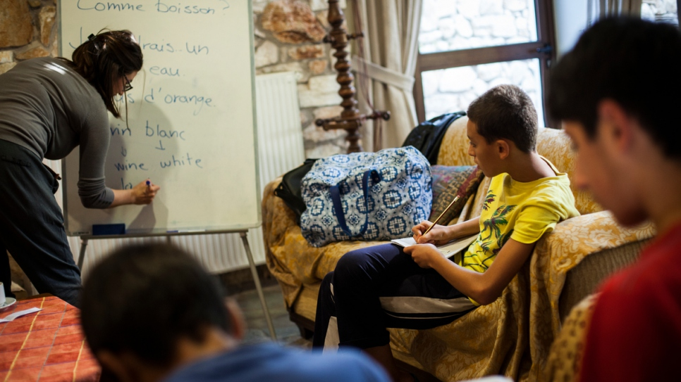 Young boys from Syria take part in a French language class.