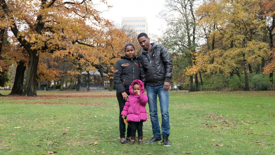 Rahel, Azoz and Dina pose for a family portrait near their home in Antwerp, Belgium.