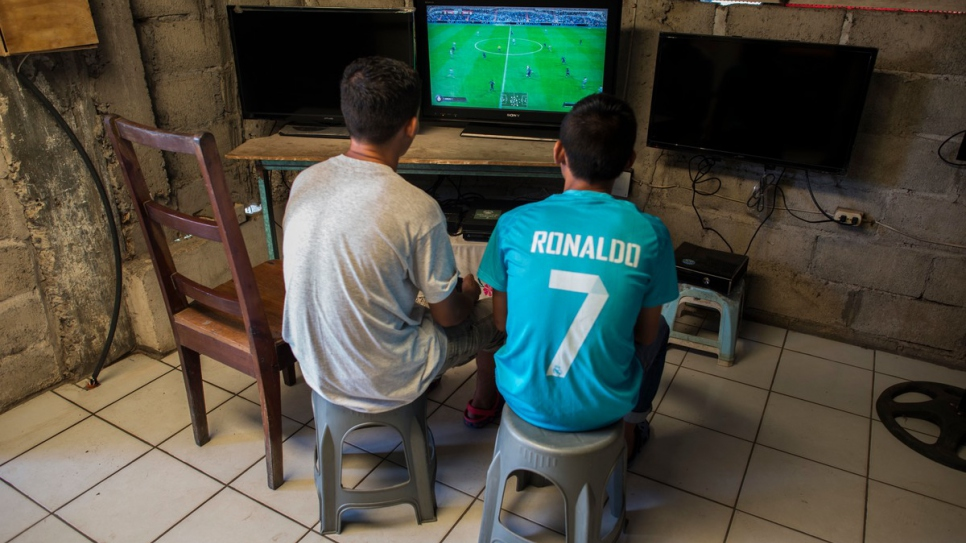 Moises and Anderson play a video game at a local store.