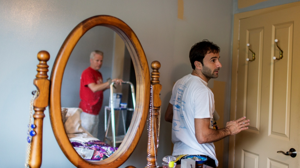 Dave, a local volunteer, hired Husam to work part-time as a painter.