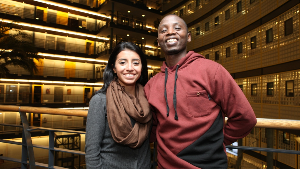 Laura Elizabeth Valencia Restreppo, a Colombian refugee living in Ecuador, and Joseph Munyambanza, a refugee from the Democratic Republic of Congo living in Uganda, at UNHCR headquarters.